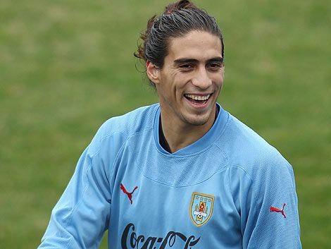 Martin Caceres ...this boy is INSANELY GOOD!!! He reminds me SO much of Camoranesi :)