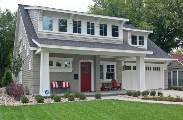 Red door against grey cape cod home with inviting front for Cape cod dormers