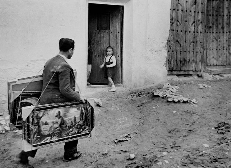 """W. Eugene Smith SPAIN. Extremadura. Province of Caceres. Deleitosa. 1951. Vendor of religious paintings. From """"Spanish Village"""" photo-essay."""