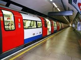 This is an average tube stop in London (The Underground).  There are a number of doors that will open the length of the tube and you can get on anywhere.  Make sure to move down the platform to give yourself the best chance of finding room on the tube.