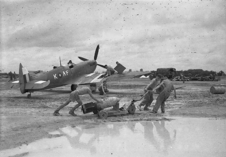Royal Air Force Operations: Airmen prepare a Supermarine Spitfire Mark VIII of No 607 Squadron for a sortie during moonsoon conditions at Mingaladon, Burma 1944
