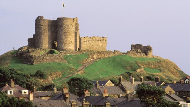 Criccieth Castle, Snowdonia, Wales. Perched on a headland with the sea as its…