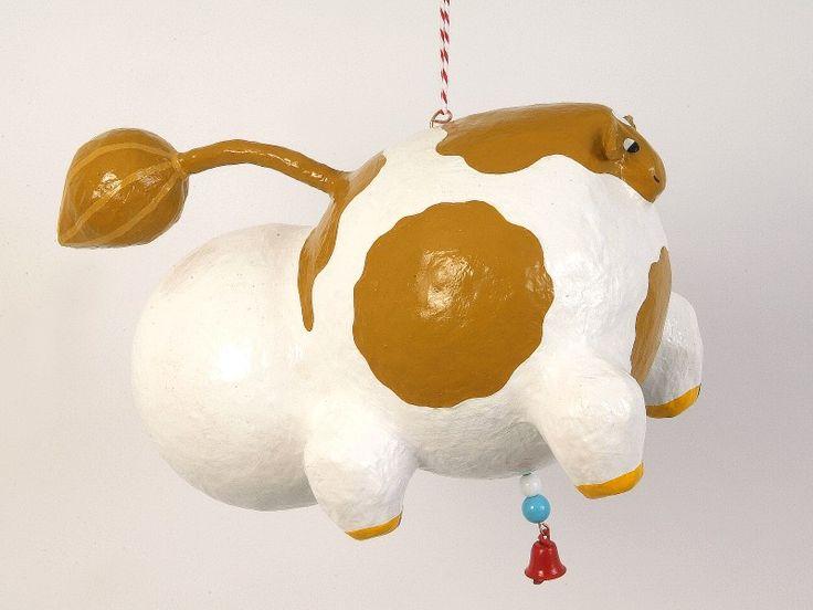 White and brown paper mache folk art cow