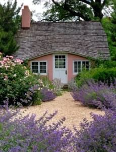 Tiny Pink Cottage With Thatched Roof. LOVE the lavender!