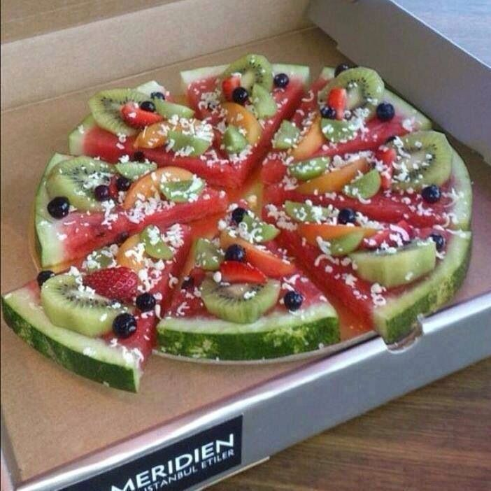 fresh watermelon pizza! :)) the white topping is coconut flakes. clean eating. <3: