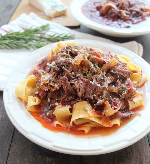 Beef Ragu Recipe 1 large onion (sliced) 4 garlic cloves 2 tbsp fresh rosemary (chopped) 2 lb beef chuck roast 1 tsp kosher salt 1 tsp black pepper 2 cups beef broth ¼ cup red wine 1 can (6 oz) tomato paste 1 can (15 oz) diced tomatoes 12 ounces pappardelle pasta or polenta ½ cup Parmesan cheese (grated)