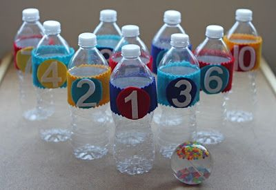 Turning small recycled plastic water bottles into DIY Bowling Pins is a wonderous gift sent by the boredom angels.