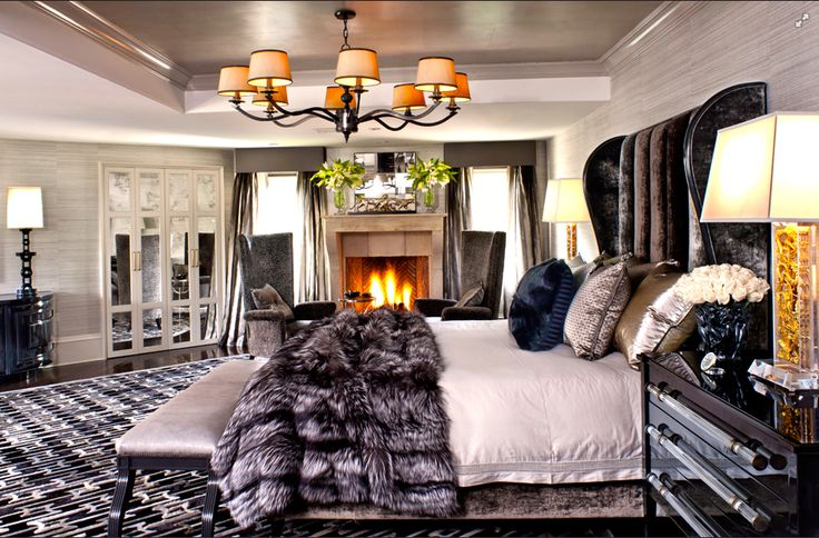 Spacious master bedroom with access to : Double walk in closets and his and her bathroom  Space for a : Gas fireplace and two armchairs  Extra length king size bed