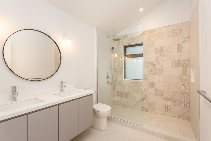 The children's bathroom with Azulej tiles from Mutina and a custom vanity, with Corian top and undermount sinks.
