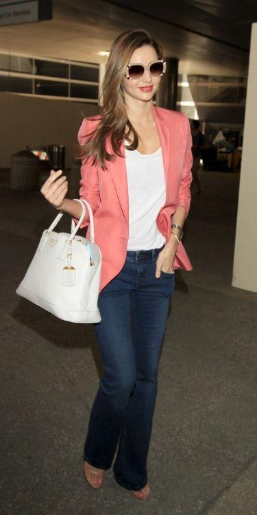 Miranda Kerr street style with bright coral blazer, white T-shirt, denim wide leg jeans and Prada handbag. #mirandakerr