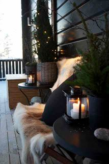 Black and white front porch winter decor with lanterns. Rustic and Cozy