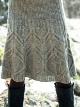 Berroco ~ Dickerson Skirt: A wide ribbed waistband flows into a cascade of cables on this knee-length skirt knit from the top down.
