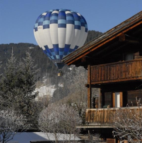 Les Fermes de Marie, Megève // Vol en montgolfière survolant le Hameau d - Hot air balloon flying over the Hamlet http://en.fermesdemarie.com/376-exteriors-winter.htm