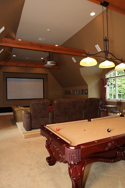 Add wood beams to ceiling and wrought iron light fixtures