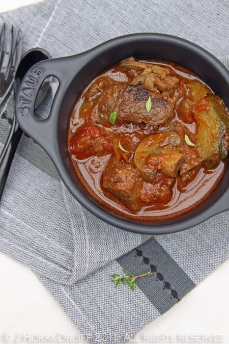 "Beef brisket with braai (BBQ) sauce potjiekos - (a literal translation for potjiekos is ""little pot food""). These days, they are used as a kind of open-air crockpot in which food is stewed slowly in a closed pot over hot coals, to emerge tender and fragrant and delicious . For anything between one and four hours (depending on what you are cooking), there is little for the cook to do except replenish the coals under the pot."