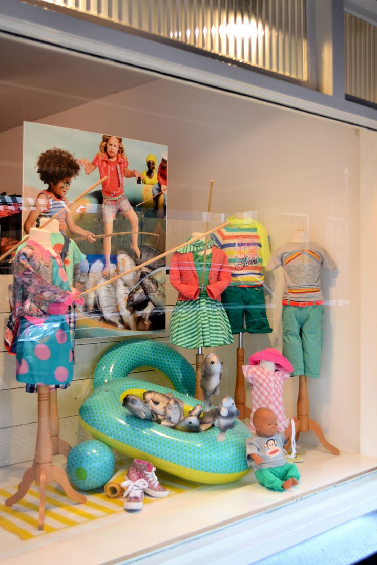 Beach themed shop window summer kids clothes made by for Boutique window display ideas