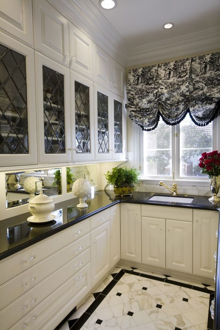 Love the beautiful cabinets, window treatment and flooring in this butler's pantry.