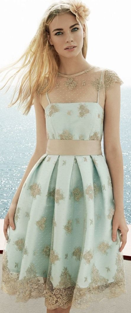 Matilde Cano 15: mint dress with nude floral patterned lace.