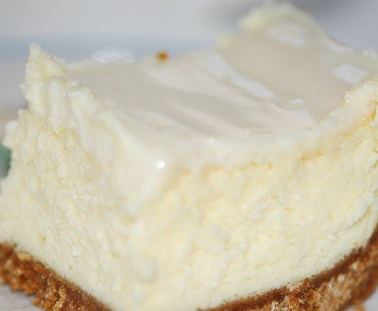 cheesecake with sour cream topping in 13 x 9 pan