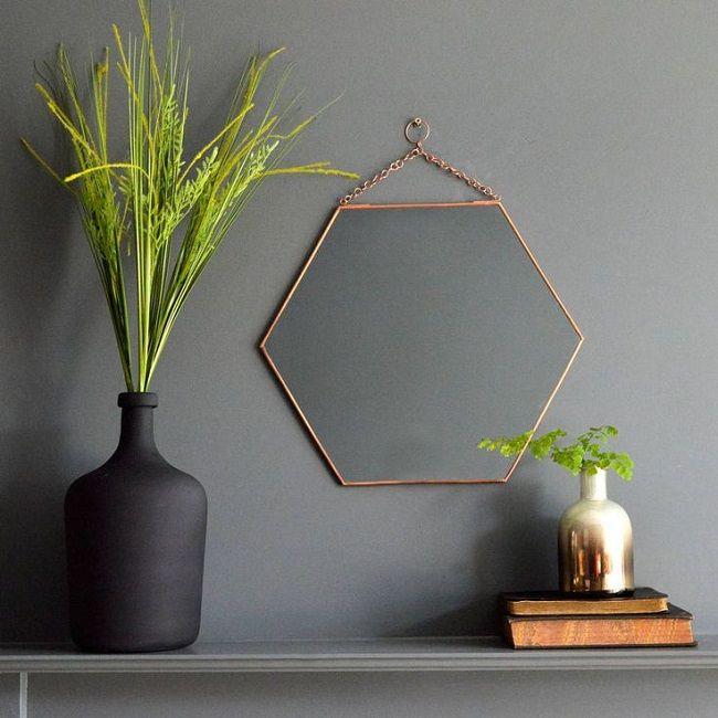 copper living room, hexagonal mirror