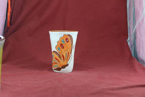 This drinking glass is ideal for water and beer; it can also be used as a flower vase.  This object is made of low-temperature clay, the technique Sgraffito and many different dots colors. The object is suitable for food, microwave and dishwasher.  weight=325 gram height=14 cm