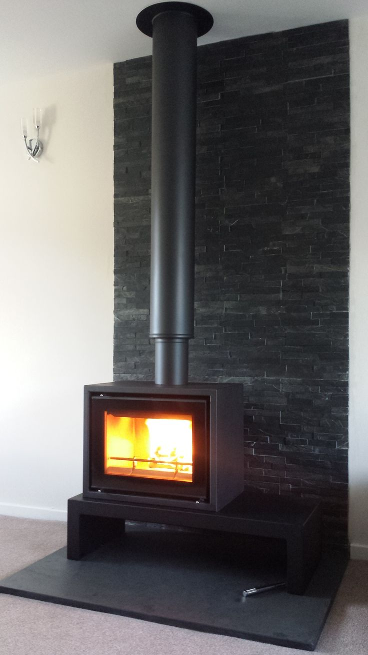Stovax studio on bench with split faced tiles. #freestanding #woodburner