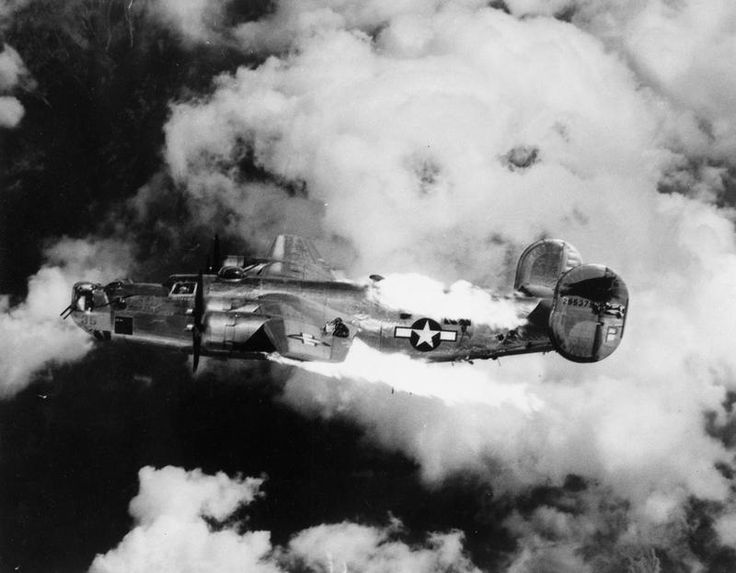A US Army Air Force B-24J Liberator bomber on fire over Austria following an attack by German fighters. A fire onboard created an immediate desperate situation with the crew in mortal danger by an explosion or disintegration of the frame. Bailing out was the only option -- and it was often unsuccessful.