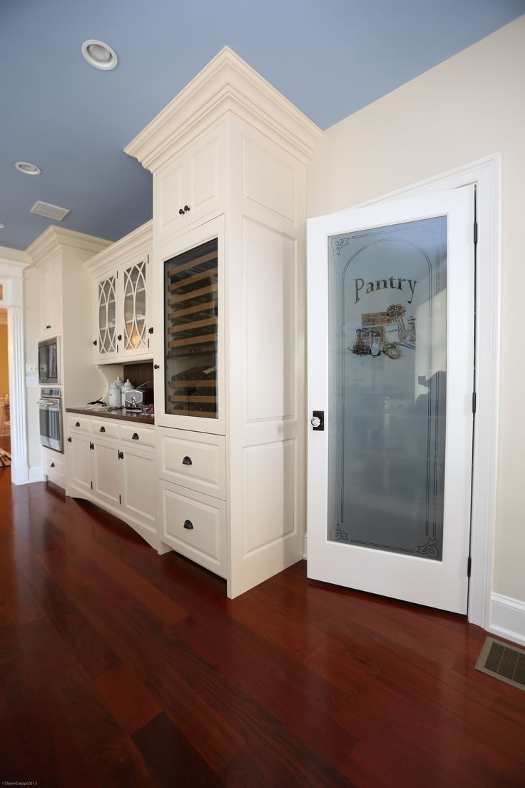 White Painted Cabinetry And Etched Glass Pantry Door Located In Longport Nj Kitchen Design By