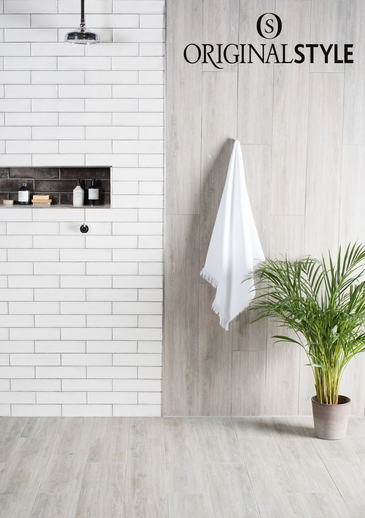 Alamo Ash paired with Montblanc White from Original Style's Tileworks collection. Use the combination of the smooth wood effect tile with the high gloss montblanc, to create a contemporary bathroom look.