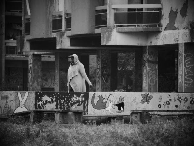 A resident of the banlieues overlooking her neighborhood.