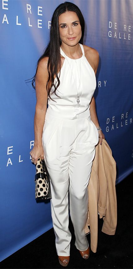 Demi Moore stunned at a gallery opening in West Hollywood in an optic white Katharine Kidd jumpsuit. The actress worked her signature long, tousled hair style and kept her look crisp and clean with simple add-ons.