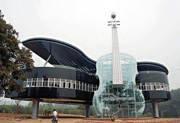 A see-through violin leaning up aga