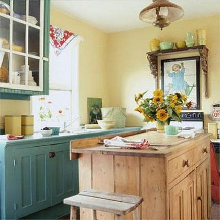 Country Kitchen With Yellow Walls Has A Vintage Look And Mix Of Cabinets From Natural