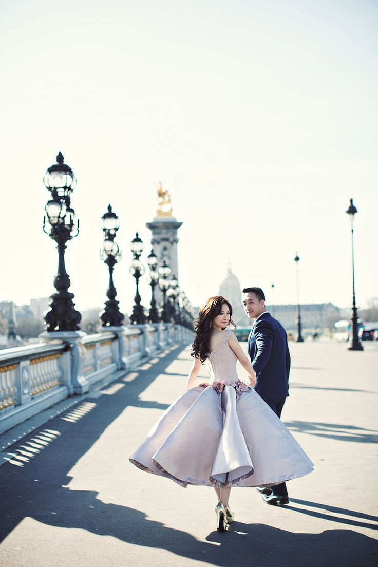 A romantic engagement shoot in Paris with seriously chic wedding gowns // Click to see more destination engagement shoots that are guaranteed to give you wanderlust  (Instagram: theweddingscoop)