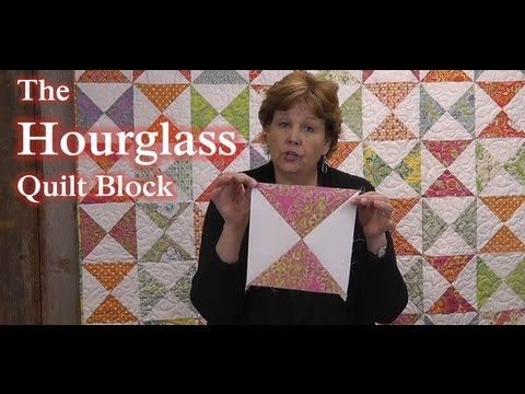 The Hourglass Quilt Block - Learn to Quilt!  72x81 quilt using one print and one solid Layer Cake.