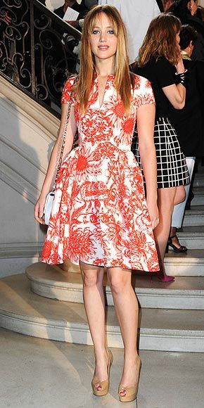 Jennifer Lawrence in Dior at the Dior Haute Couture show...Not sure about that Hunger Games hair but the dress is great!