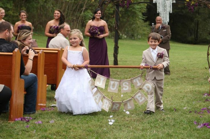 Just married sign w/ flower girl and ring bearer