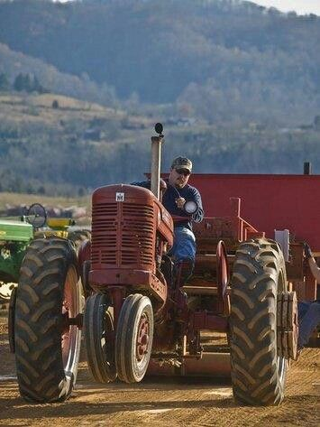 Farmall pulling a weight sled