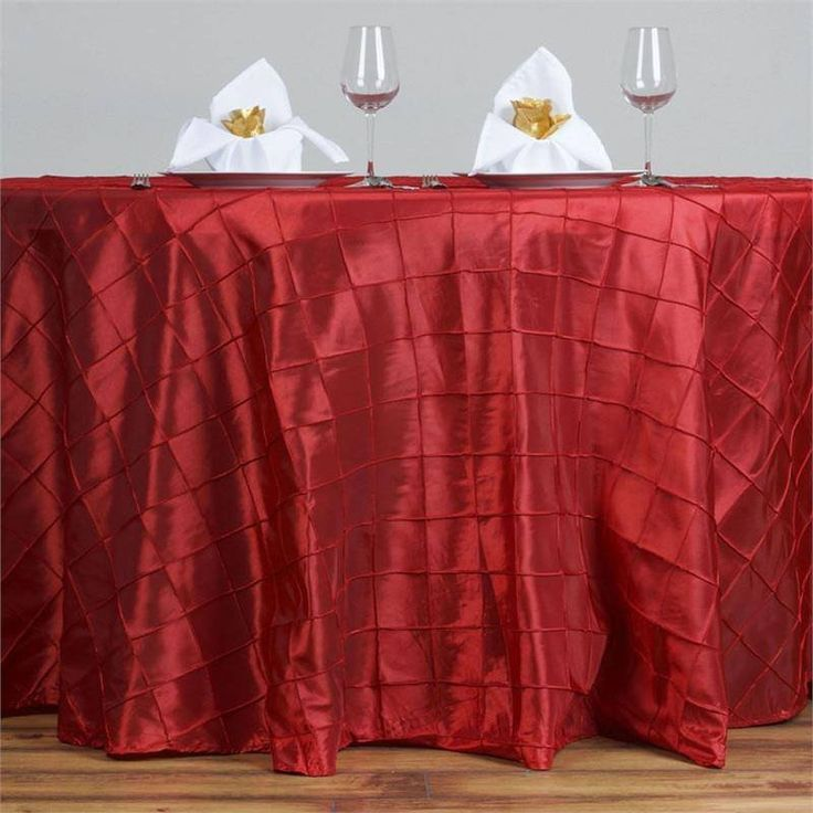 "Red Pintuck Tablecloths 120"" Round - Pintuck is actually a fold of fabric that is stitched intricately to hold it in a place, very much like a pleat. These lovely pleats impart a decorative effect to the fabric by fashioning a visual line at a chosen point. They effortlessly bridge vintage and contemporary styles to create a majestic new classic look. If you do not want your celebration to blend in with other weddings, birthdays, and anniversaries, try our premium quality pintuck Tablecloths…"