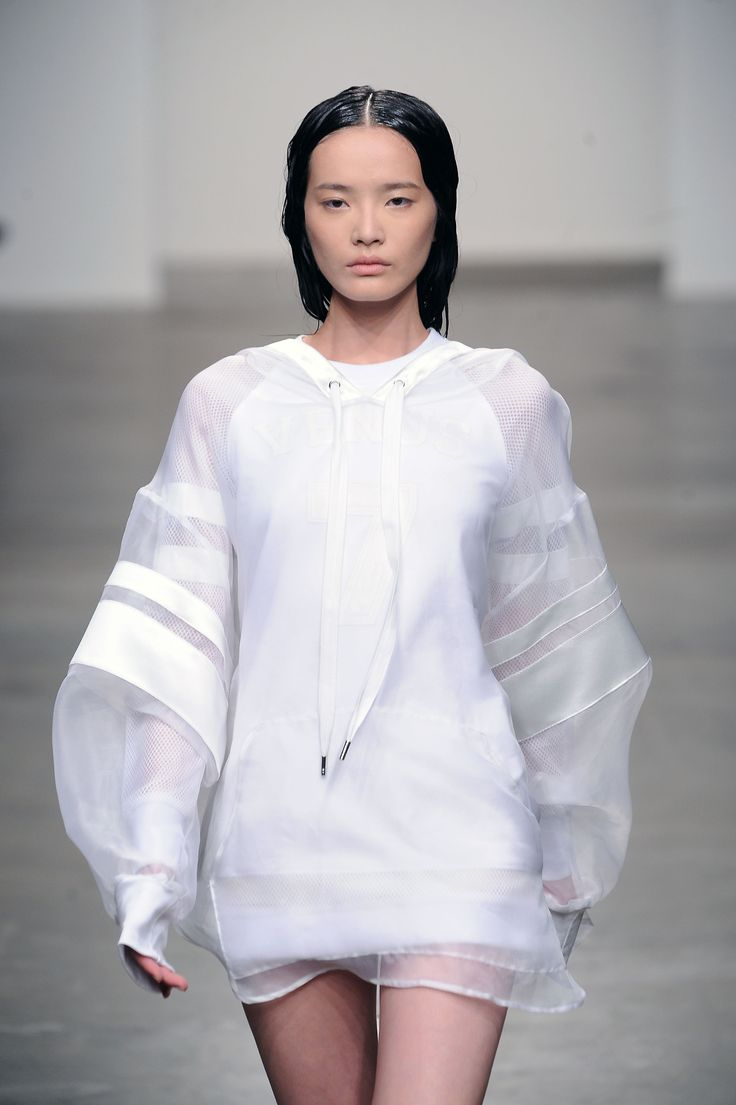 A brilliant execution of the minimalist sport trend at skingraft yesterday. We're loving the voluminous sheer sleeves with luxe stripes on this oversized hoodie #nyfw #ss14