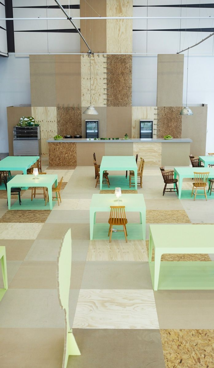 We love these sea foam green office tables, constructed from OSB.  We use it in our models because it is more sustainable, less expensive & stronger than traditional plywood!  Risingbarn.com  #green #mint #lime #furniture #office #OSB #desk #work #building #class #table