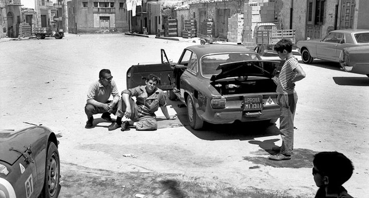 The Sicilian sunshine is beating down, and the Autodelta mechanics cannot help but take a momentary break from working on Cabral's stricken car, much to the delight of the young race-goer who's been afforded the chance to ogle the Alfa virtually uninterrupted. All that's missing is a makeshift lunch and several bottles of Chianti (for the crew's consumption, of course), and this could be the quintessential Italian snapshot. Photo: GP Library via Getty Images