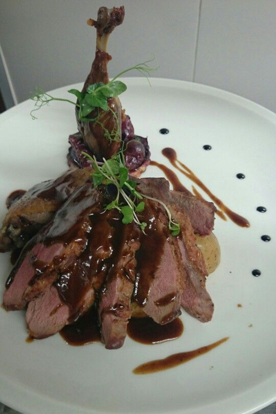 Pan fried duck breast and confit leg, plum tart tatin, honey and thyme jus.