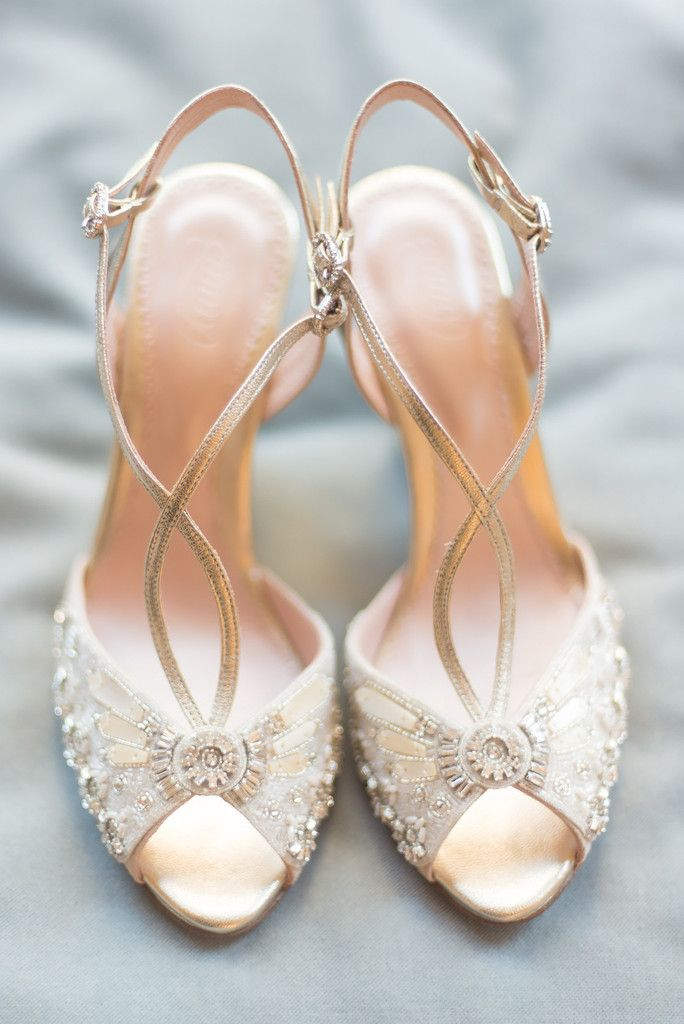 The Evelyn bridal shoe is a blush suede and gold leather peep toe with both the front and wedge heel adorned with our signature hand beaded mother of pearl and crystal embellishments. This is a stunning stand-out shoe that we are thrilled to introduce to our brides. Evelyn is a brilliant investment piece that will work wonderfully for the big day and beyond. http://www.emmylondon.com/collections/bridal-shoes/products/evelyn
