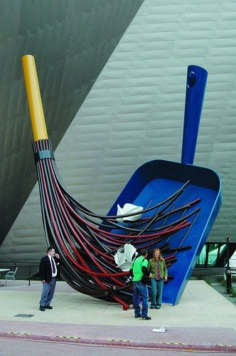 This sculptour is by Claes Oldenburg. I like this sculptour becuase it is scary how it looks like the people are being swept away. I also like how the sculptour constantly looks like it is going to fall because it is on a slant and there is nothing holding it up.
