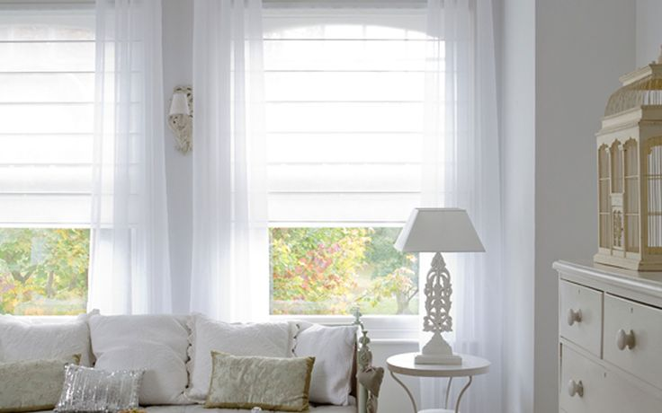 Voile Roman Blinds layered with white curtains to create a bright, airy feel