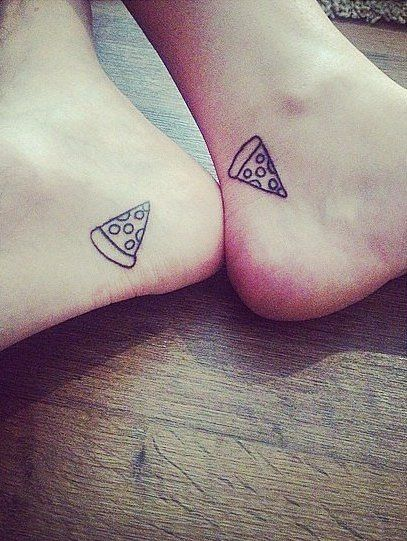 Matching pizza tattoos.