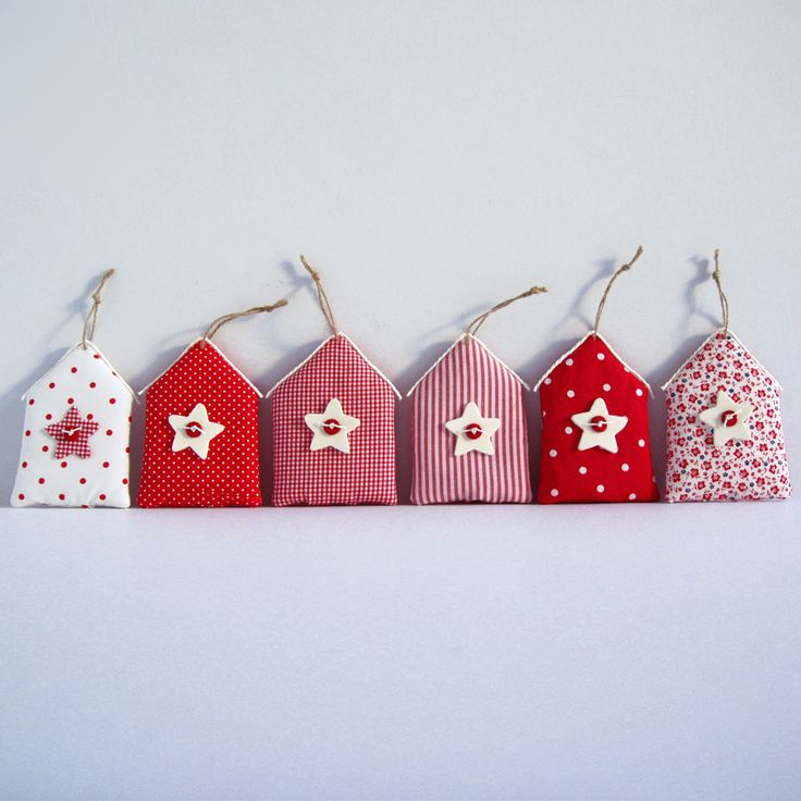 Ornaments from fabric, shaped house in 6 different shades of red, with stars decoration.