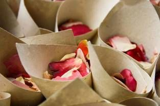 "Wedding guests love to shower the bride and groom with flower petals after they say ""I Do."" Petal cones are a simple do-it-yourself (DIY) project that any bride can create."