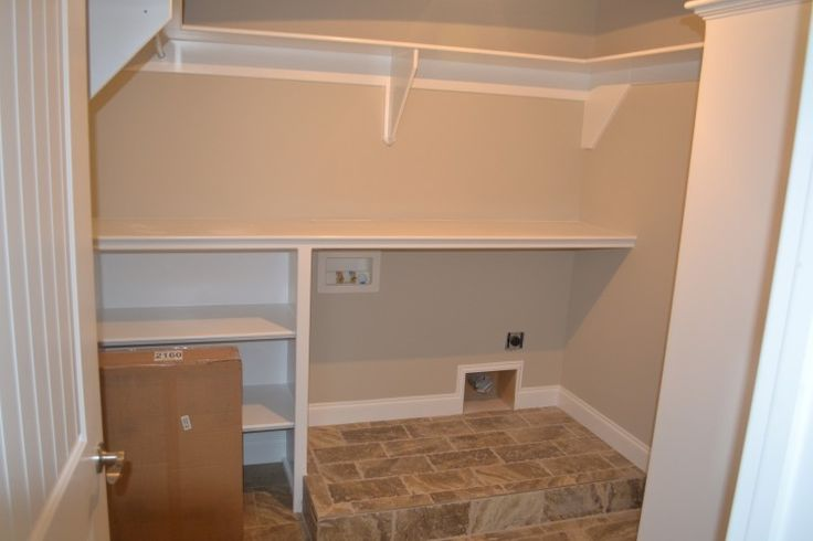 Custom Laundry Room With Raised Floor For Front Load Units And Recessed Dryer Vent Room For